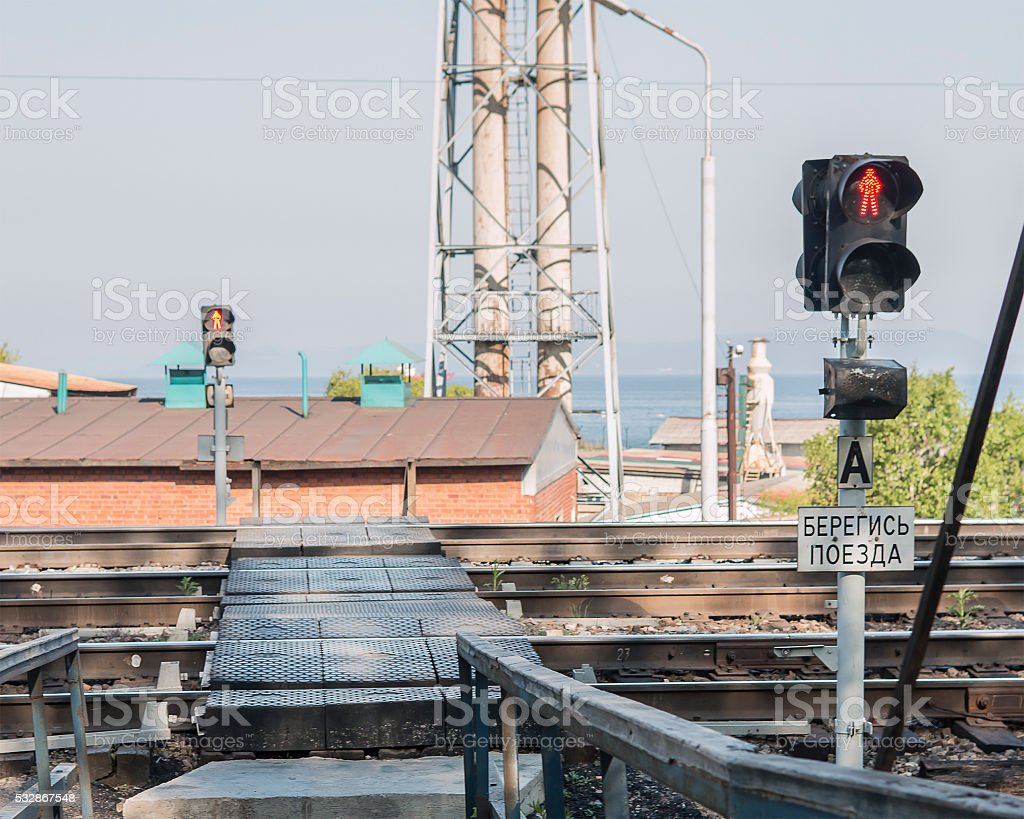 red light on a pedestrian crossing over the railway stock photo