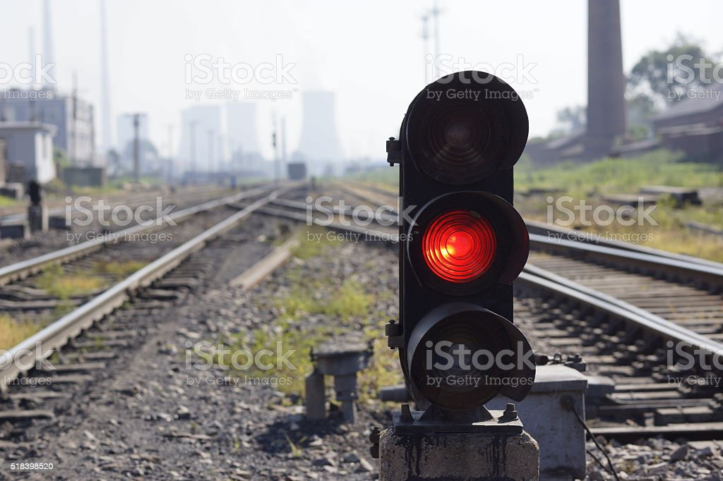 red light on railway track stock photo