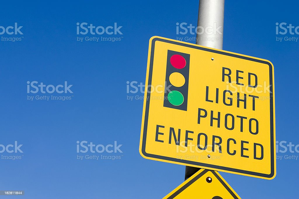 Red light photo enforcement sign stock photo
