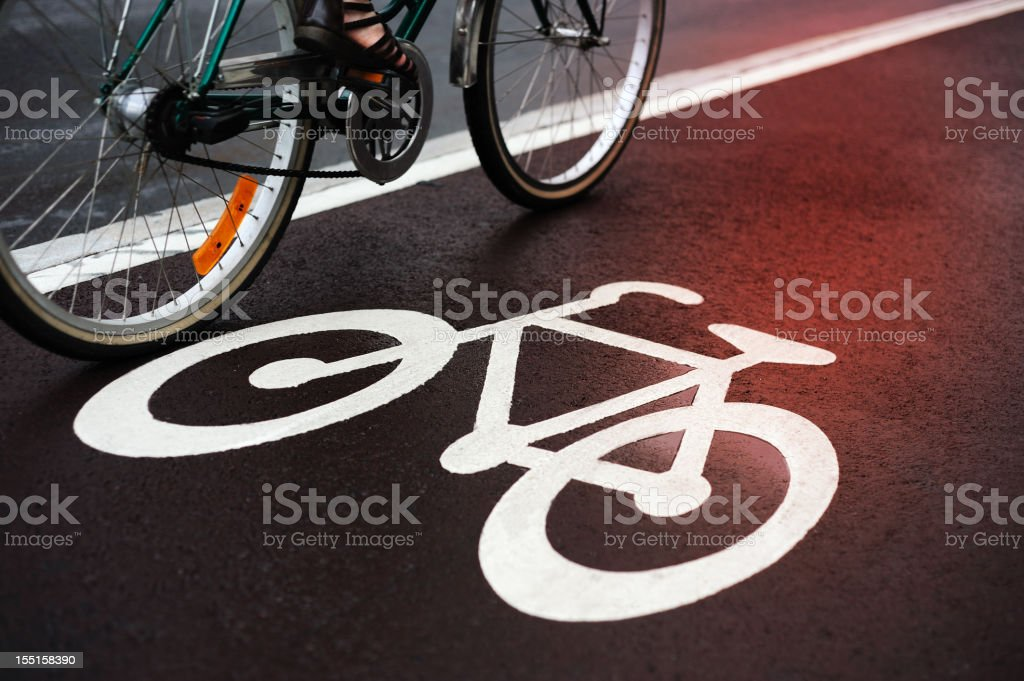 Red light reflecting in bicycle lane royalty-free stock photo