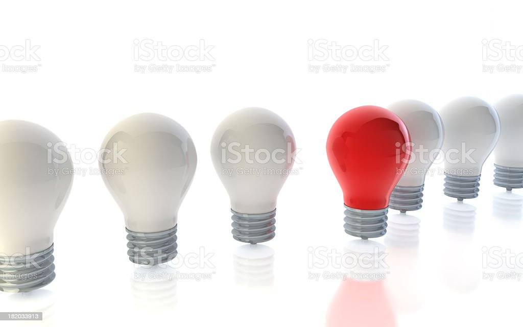 A red lightbulb standing out from crowd of white lightbulbs stock photo