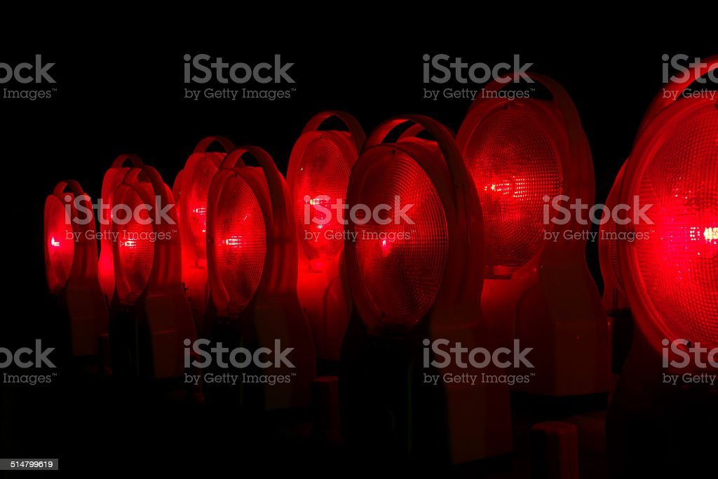 Red lighted construction sight lamps at night royalty-free stock photo