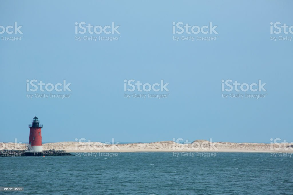 Red lighthouse and sand dunes near Cape Henlopen, Delaware. stock photo