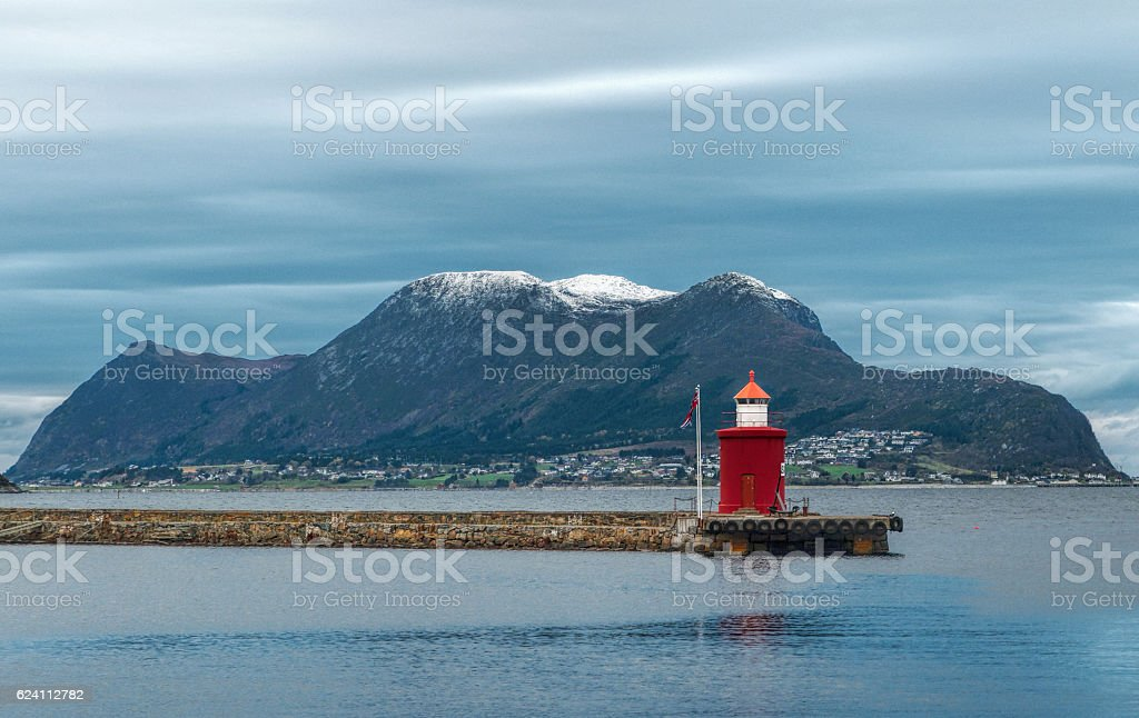 Red lighthouse at harbor of Alesund, Norway stock photo