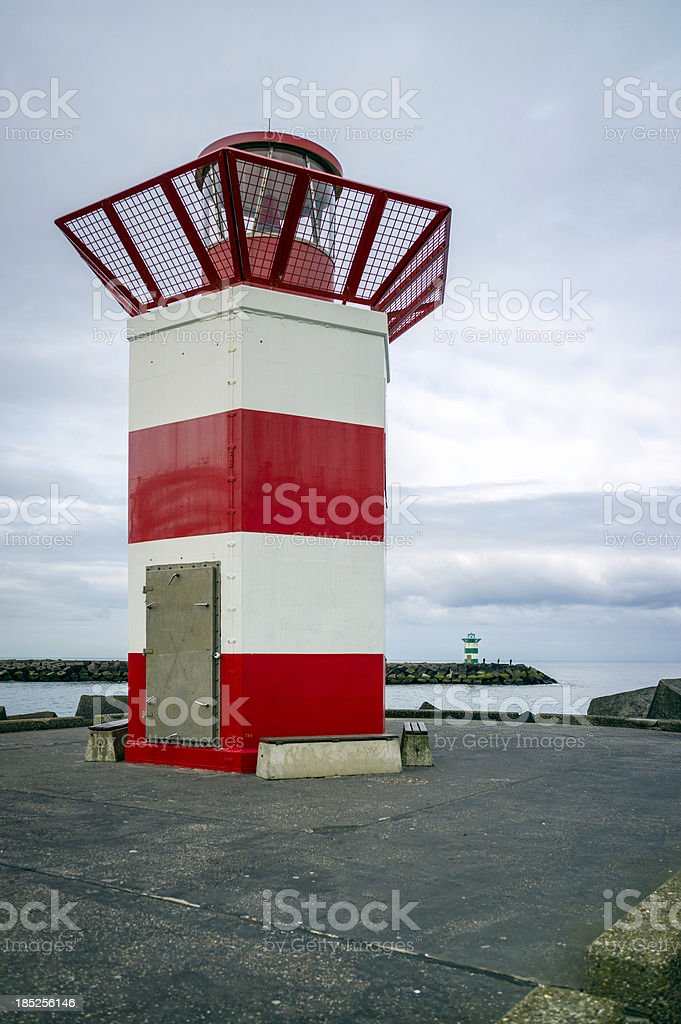 Red Lighthouse at Port Entrance royalty-free stock photo