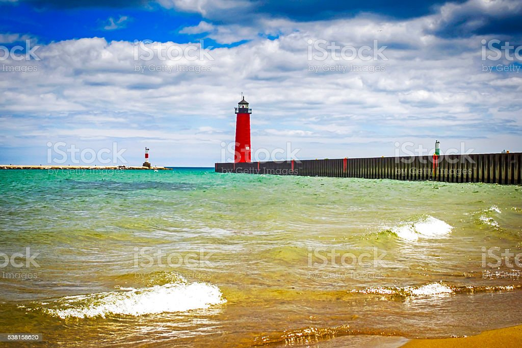 Red lighthouse at the entrance to Kenosha harbor in Wisconsin stock photo
