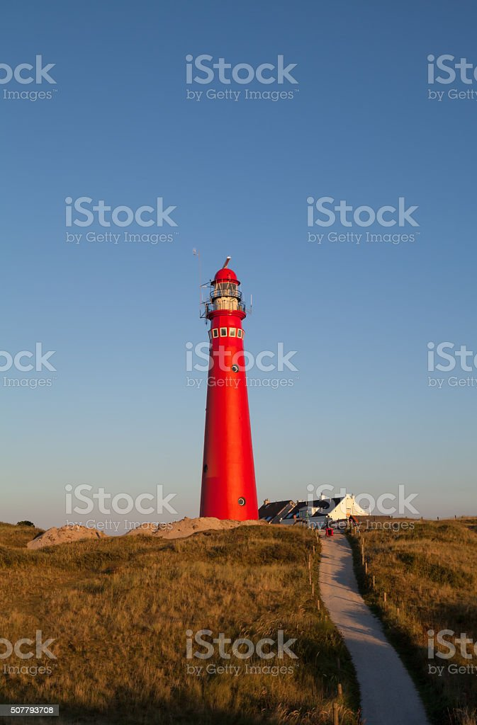 red lighthouse on Dutch island stock photo