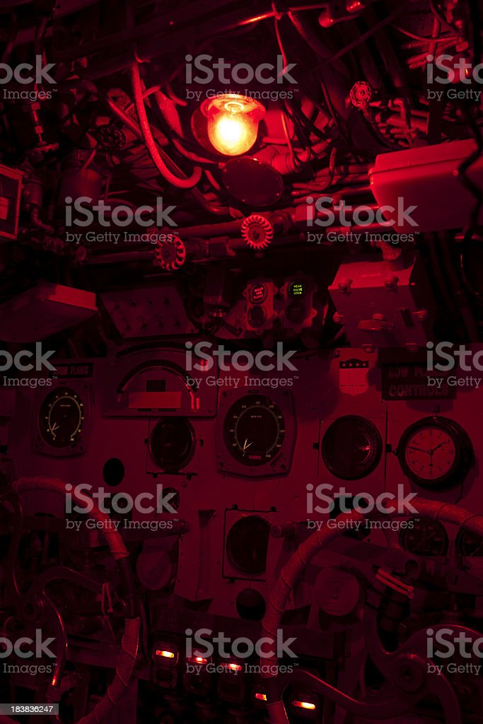 Red lighting in a WW2 submarine control room stock photo