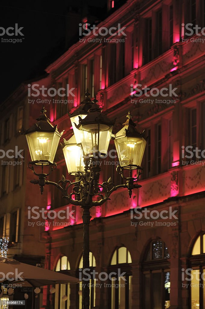 Red lighting on Strasbourg building stock photo