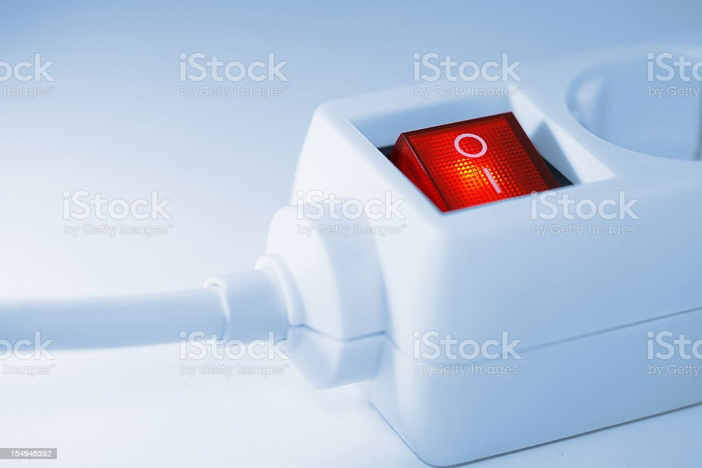 Red lighting outlet switch stock photo