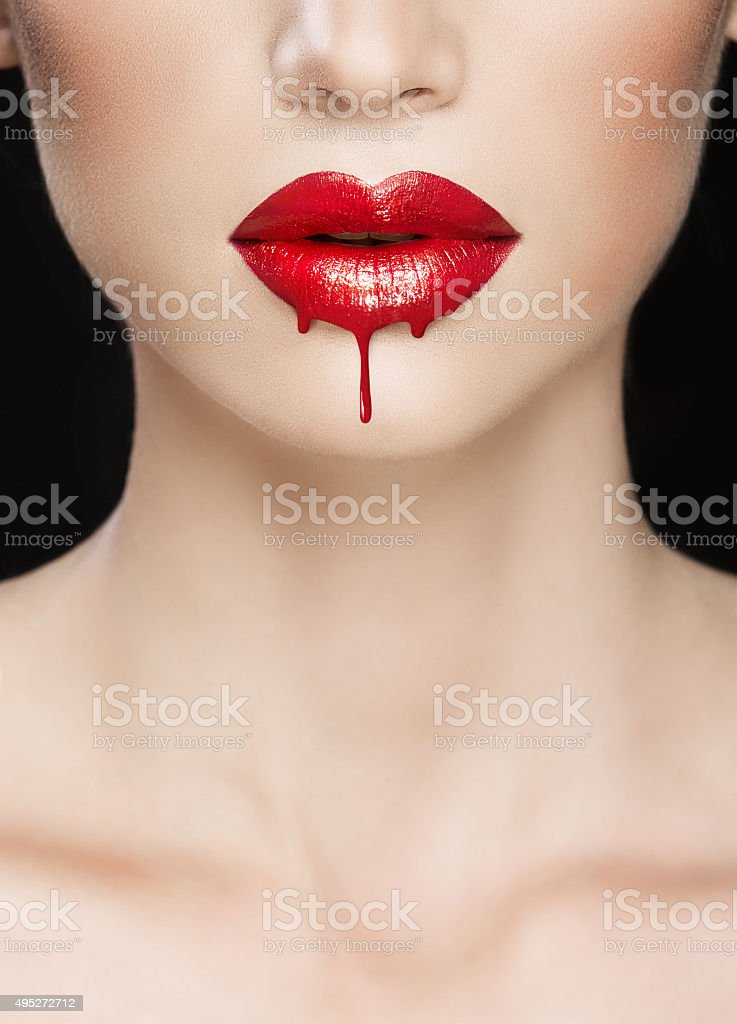 Red lips close-up, make up dripping stock photo