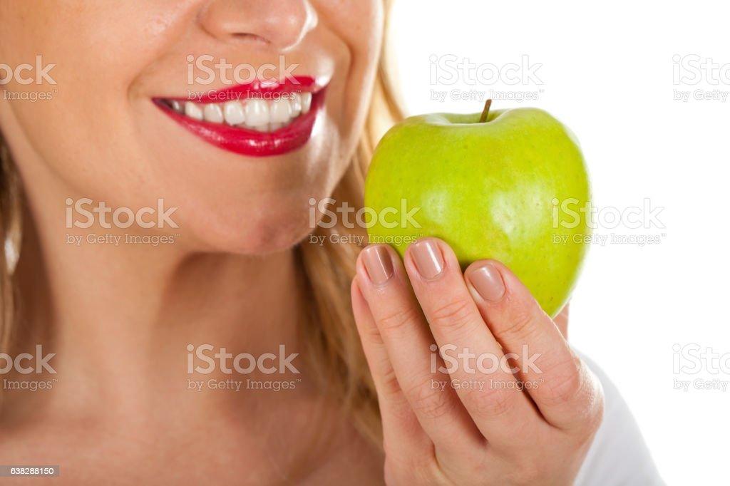 Red lips & fresh green apple stock photo