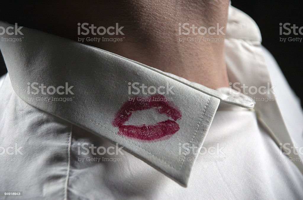 Red lipstick kiss mark on mans white shirt color royalty-free stock photo