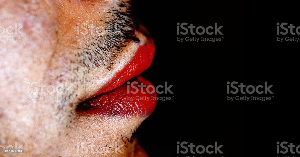 Red lipstick on man's lips stock photo
