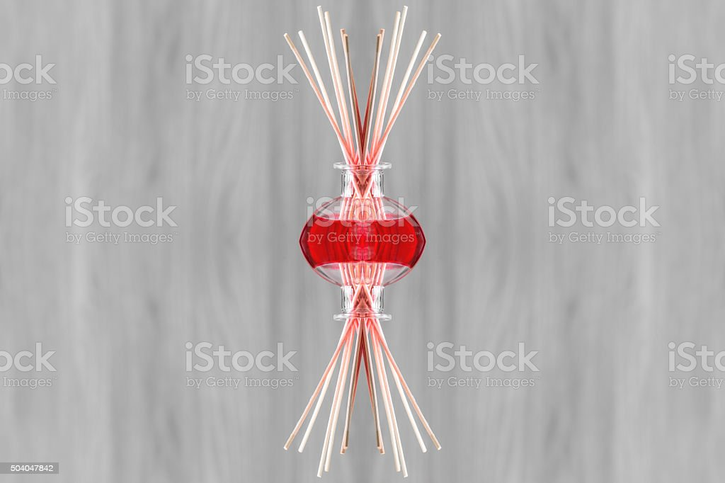 Red liquid from air freshener bottle surreal shaped symmetrical kaleidoscope stock photo