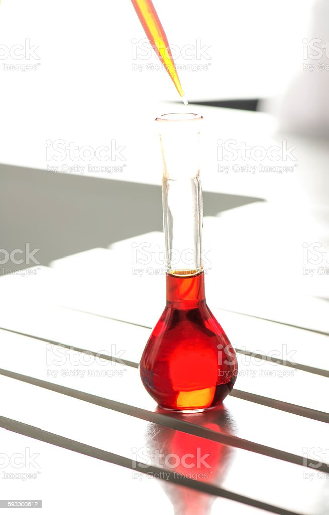 Red Liquid in Pipette stock photo