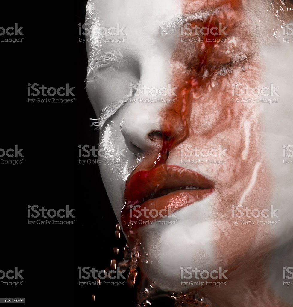 Red Liquid Runing Down White Face Painted  Woman royalty-free stock photo