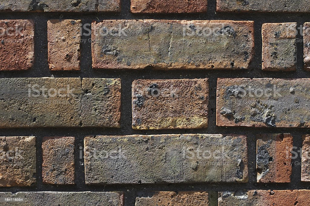 Red London brick textured add graffiti stock photo