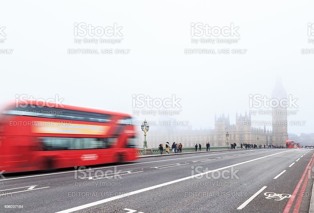 Red London bus, and tourists on Westminster Bridge. stock photo