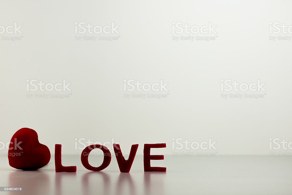 Red LOVE Letters with Heart on Table stock photo