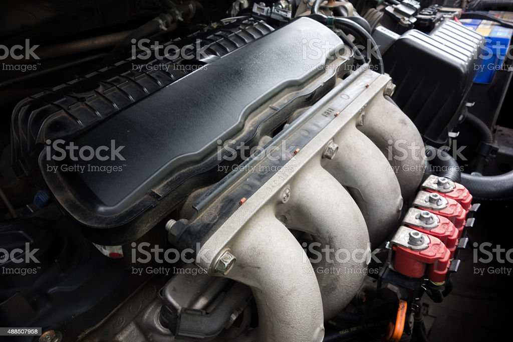 Red LPG injector with engine stock photo