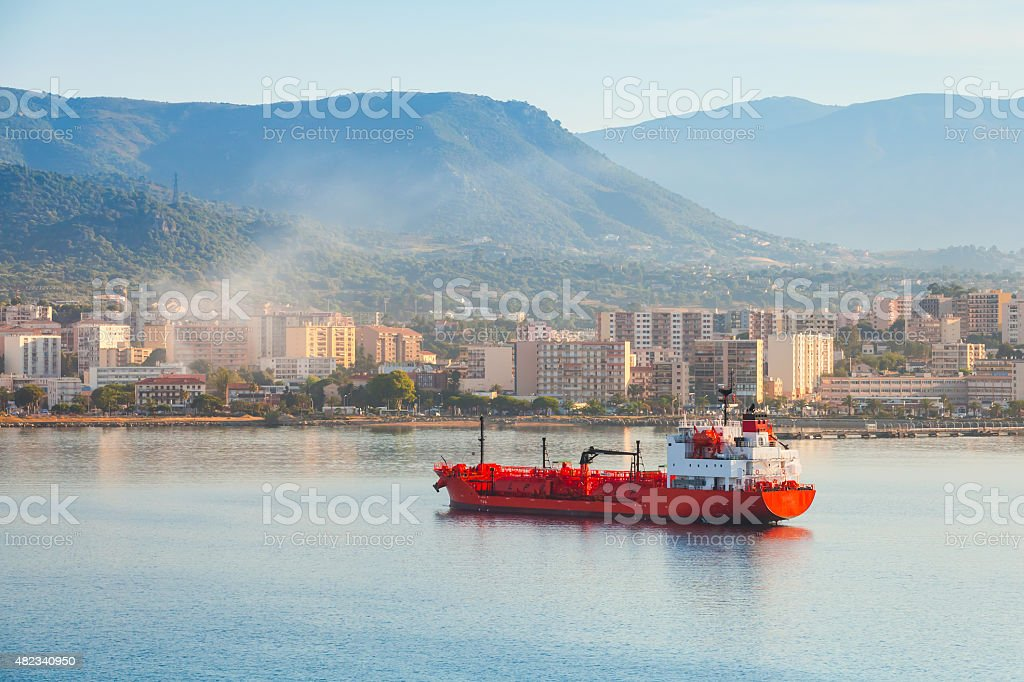 Red LPG tanker stands moored in Port of Ajaccio stock photo