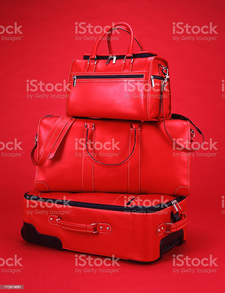 Red luggage with a red background stock photo