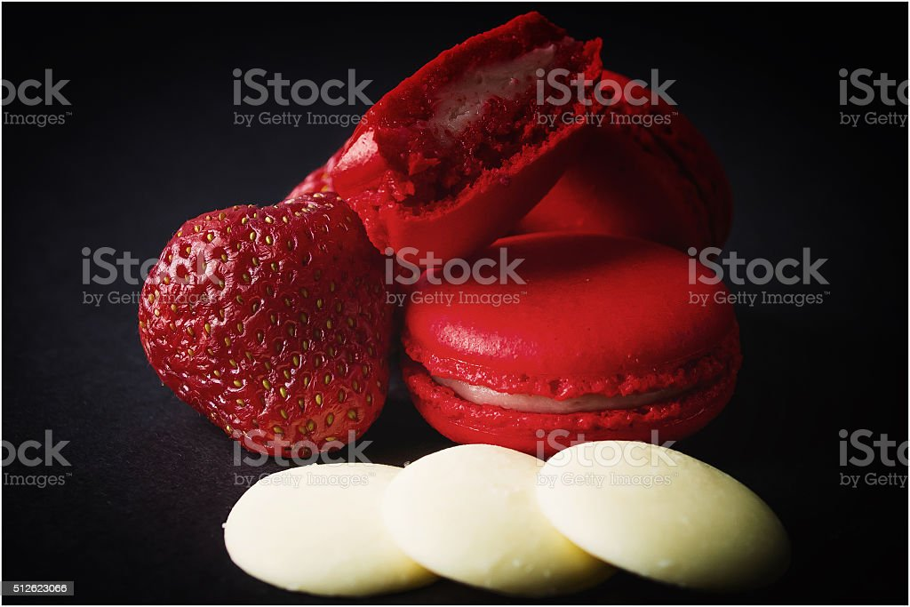 Red macaroon with strawberries and candies stock photo