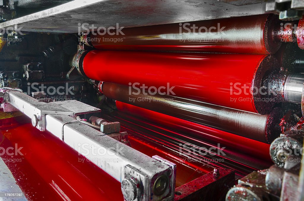 red, magenda ink color drum of web set print machine stock photo