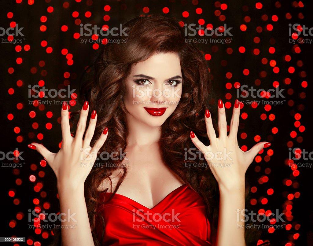 Red Manicured nails. Elegant brunette. Beautiful smiling girl stock photo