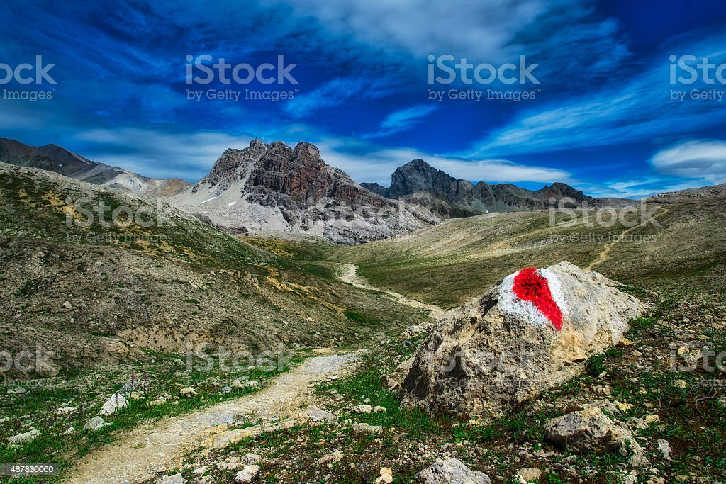 Red mark on rock to mountain trail stock photo