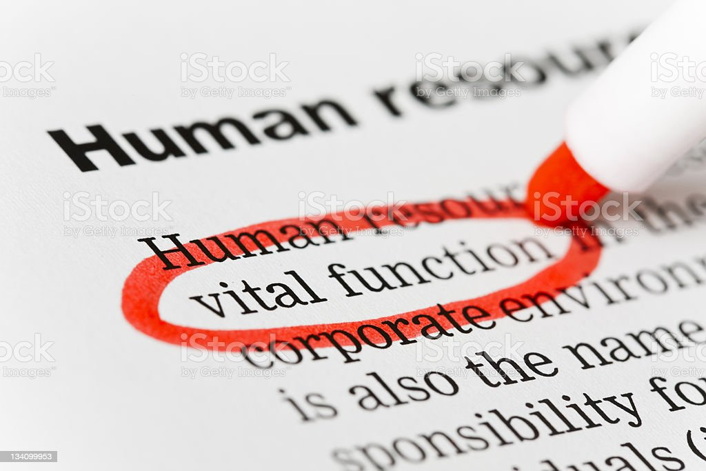 "Red marker circles ""vital function"" in Human Resources document stock photo"