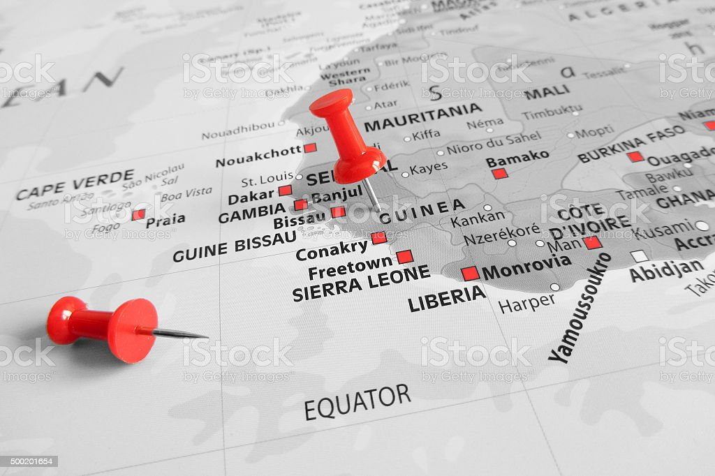 Red marker over Guinea stock photo