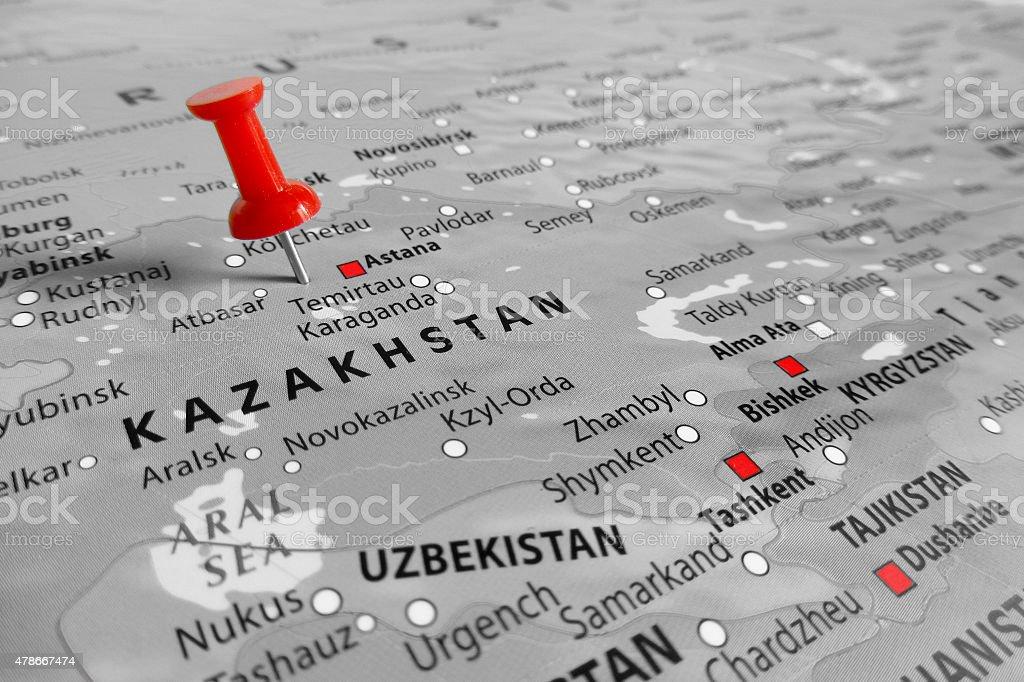 Red marker over Kazakhstan stock photo
