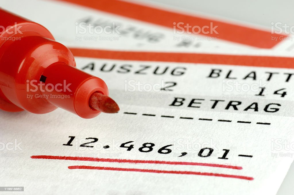 Red marker underlining sum of money in bank account stock photo