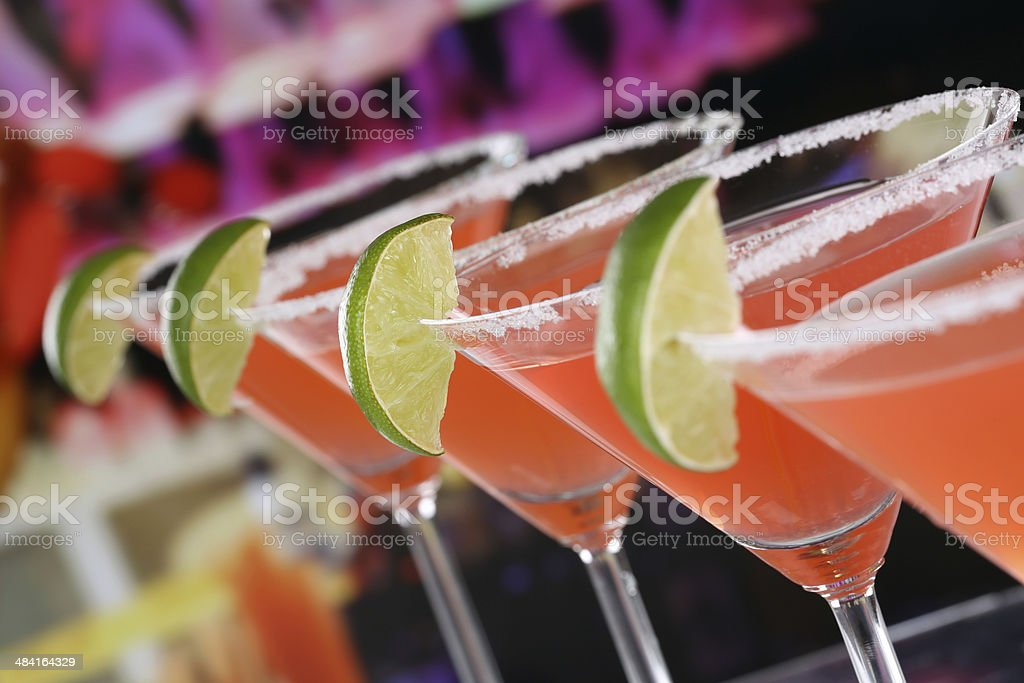 Red Martini Cocktails in glasses in a bar stock photo