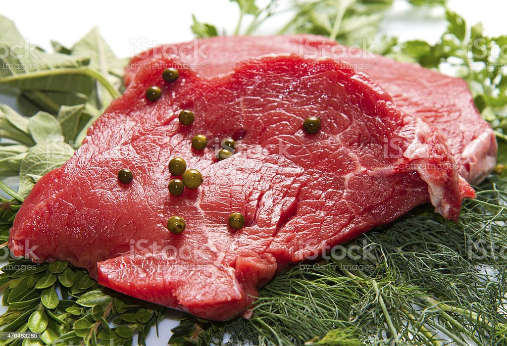 red meat with sage and rosemary isolated on white background royalty-free stock photo