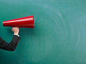 Red Megaphone In Human Hand On Green Blank Blackboard