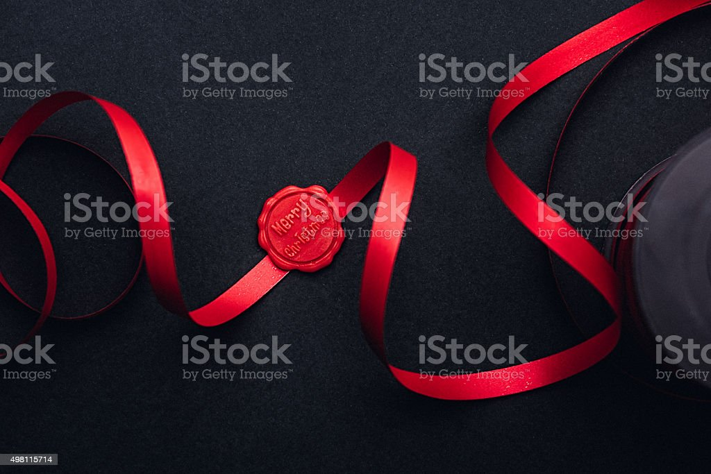 Red Merry Christmas stamp seal wax and ribbon stock photo