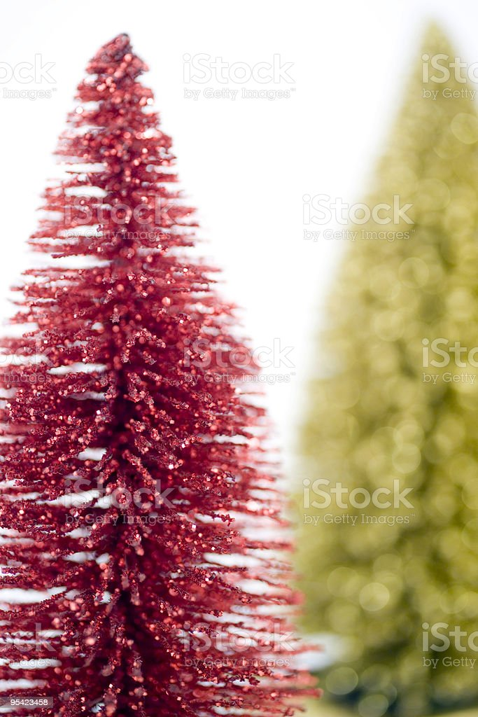 Red metal christmas tree with gold one out of focus stock photo