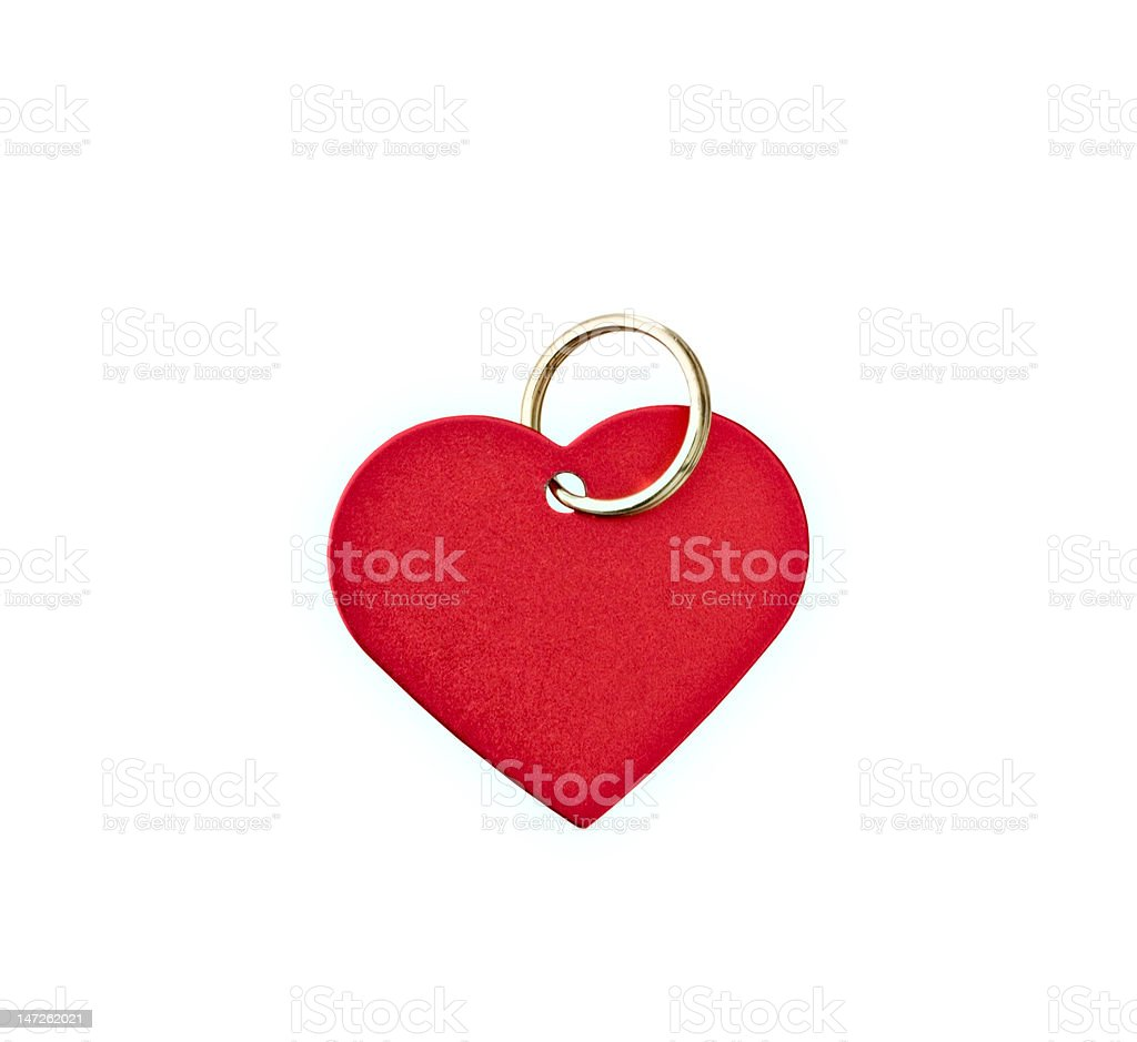 Red metal heart-shaped tag stock photo