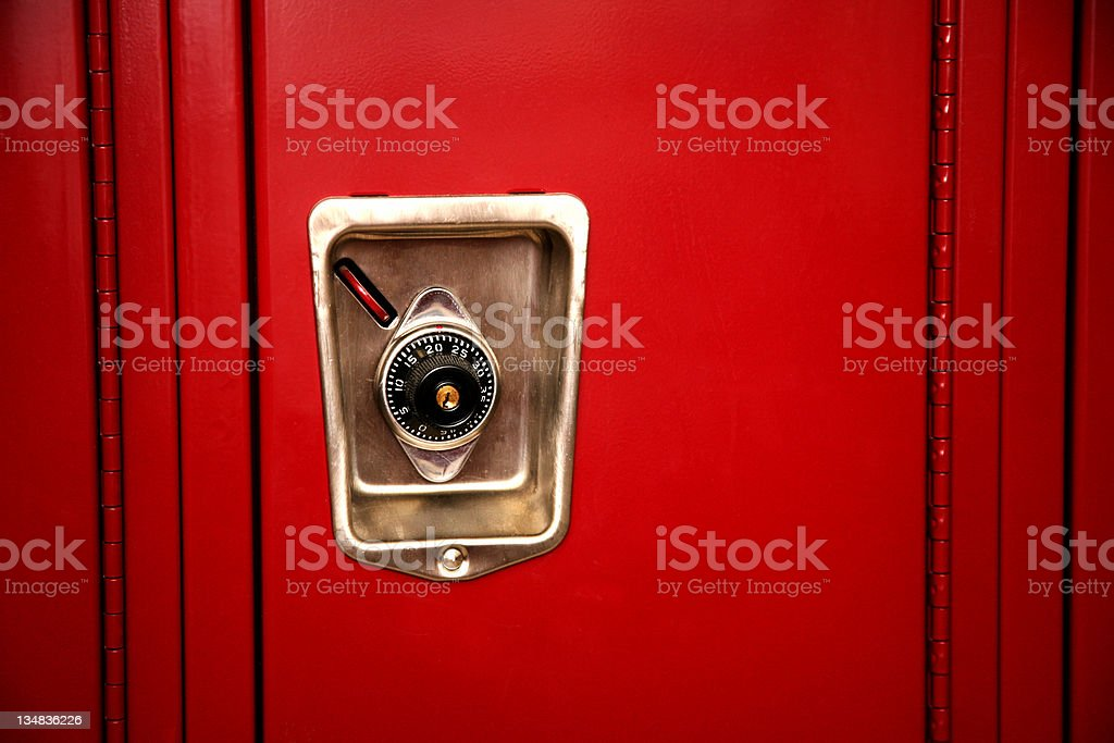 Red metal locker in a school building with combination lock royalty-free stock photo