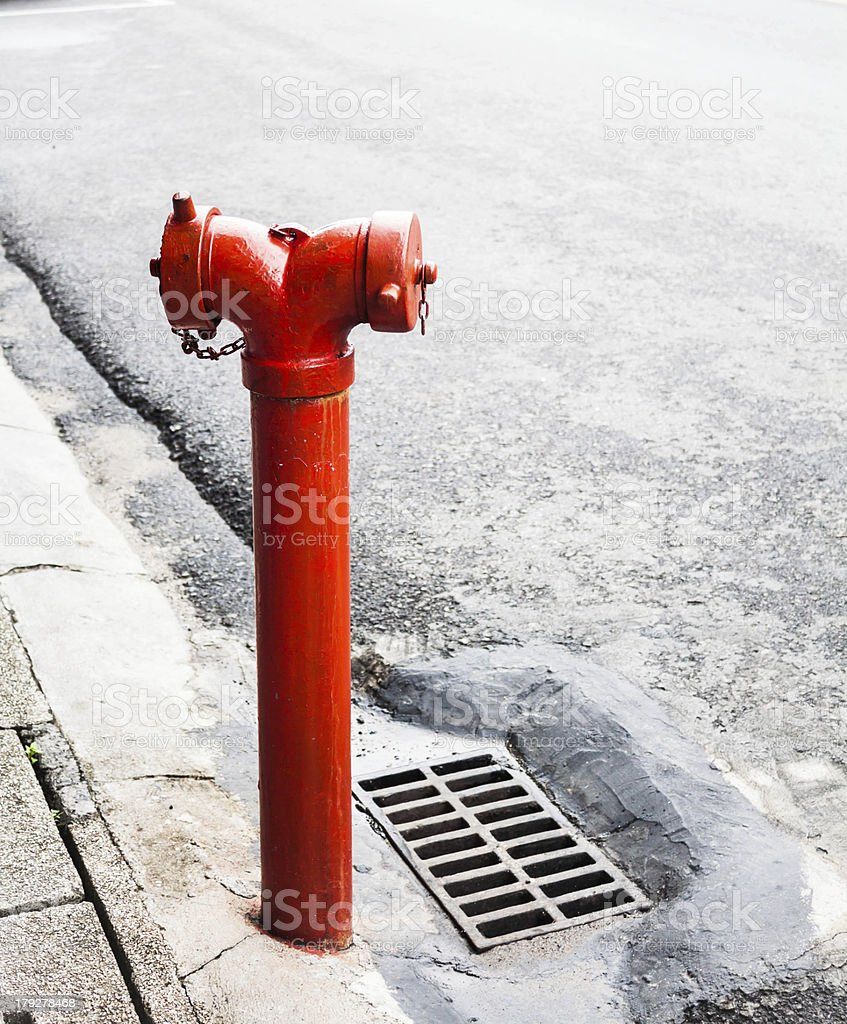 Red metallic fire hydrant on the street royalty-free stock photo