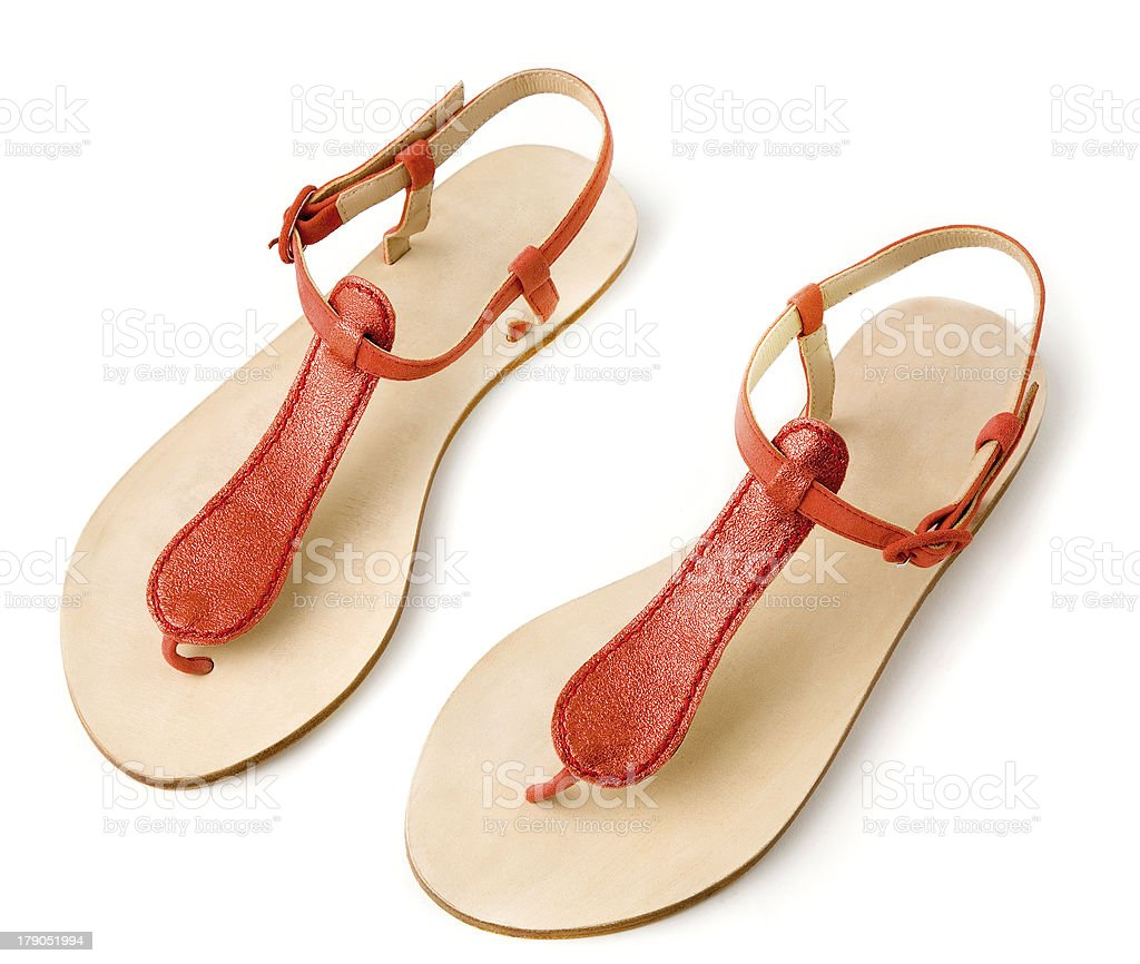 Red metallized leather flip flop sandals stock photo