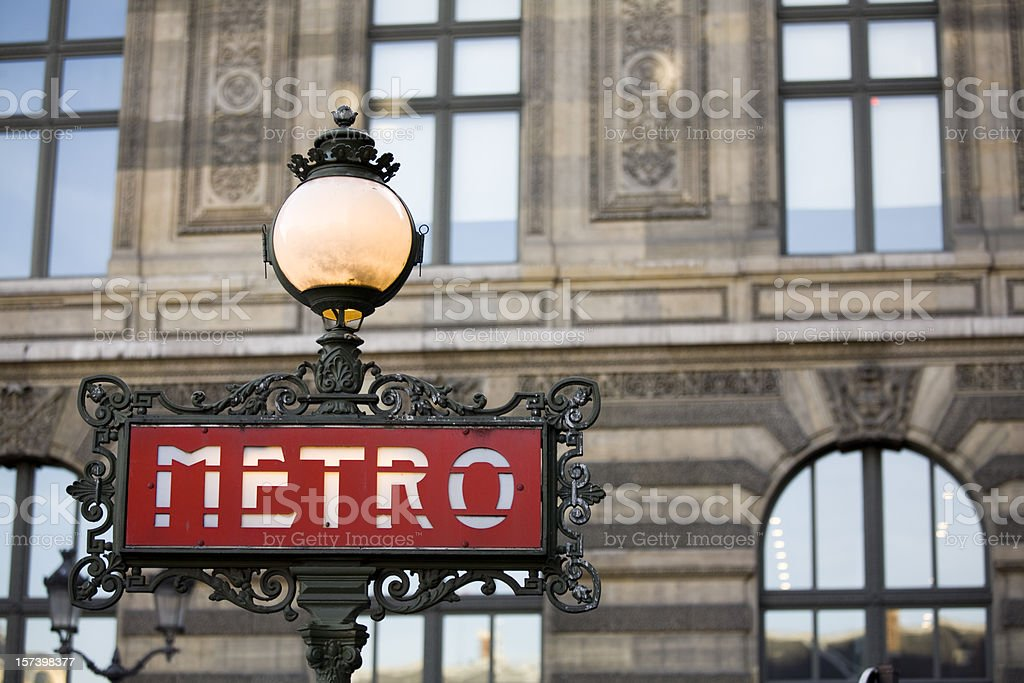 Red metro sign with light in Paris, France stock photo