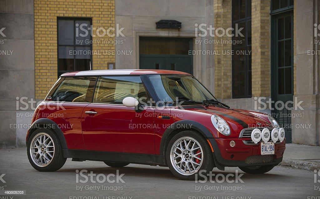 Red Mini Cooper in spring time stock photo