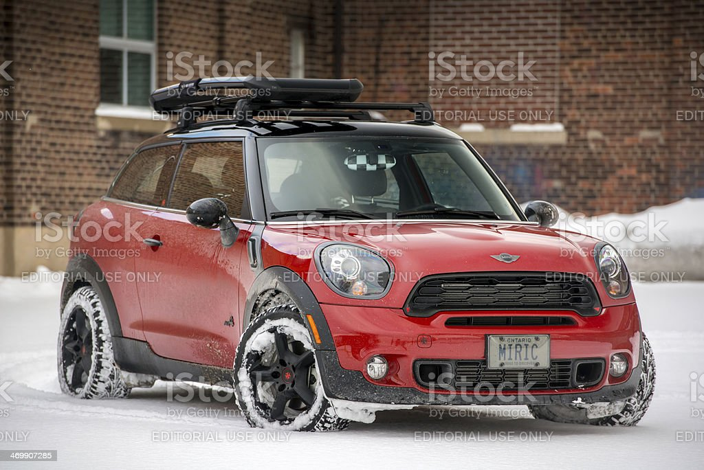 Red MINI COOPER Paceman in the snow royalty-free stock photo