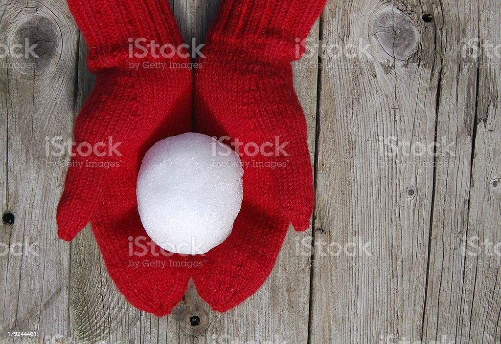 Red Mittens and Snowball stock photo
