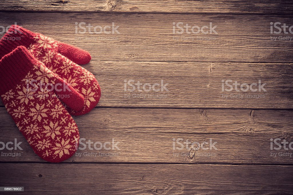 red mittens on wooden background stock photo
