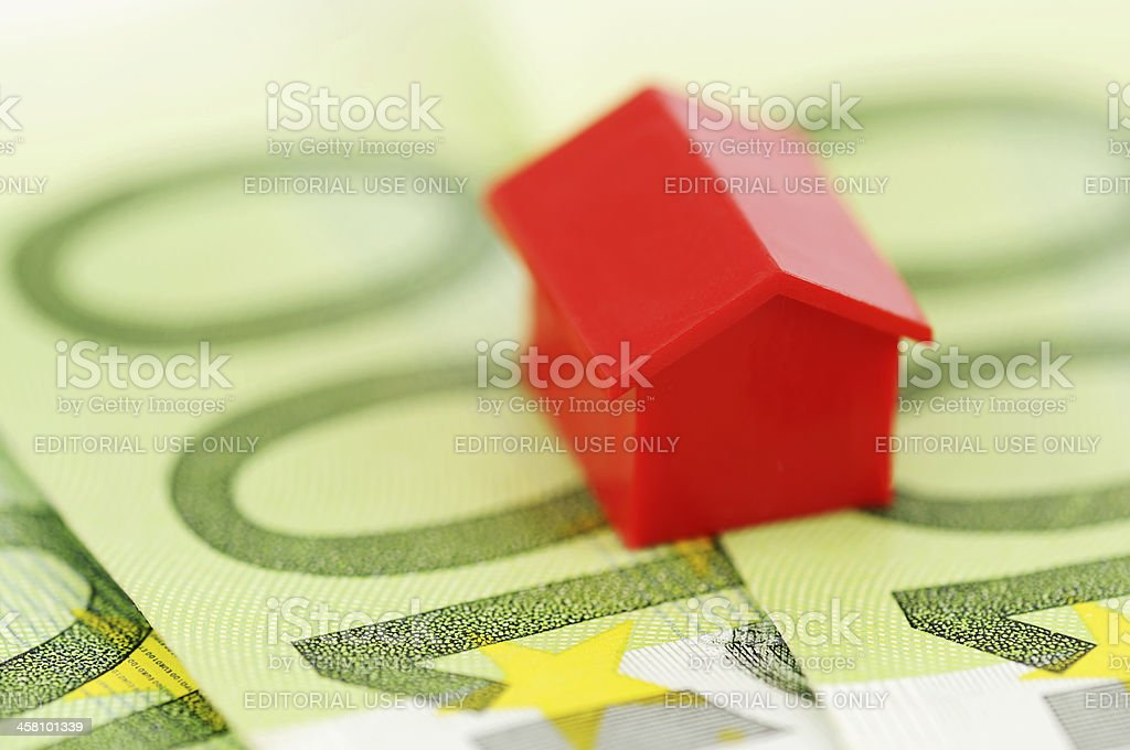 Red model house and banknotes stock photo